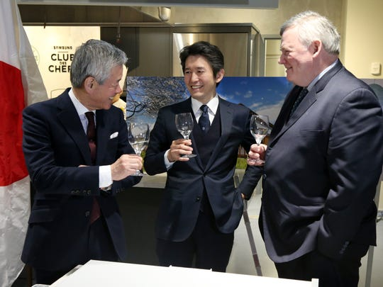 From left, Sakurai, chairman, Kazuhiro Sakurai, president of Asahi Shuzo speak with CIA president, Tim Ryan during Tuesday's press conference for the Asahi Shuzo sake brewery on April 10, 2018.