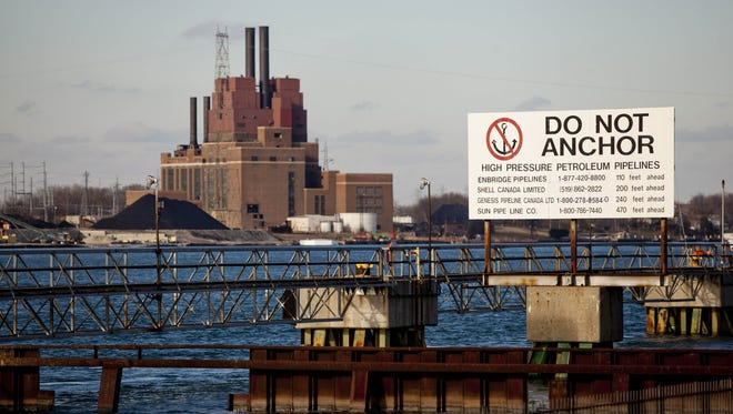 A sign warns boaters of pipelines under the St. Clair River Friday, Jan. 2, 2015 in Corunna, Ontario.