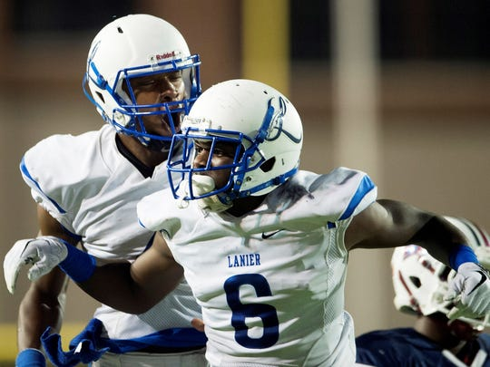 Sidney Lanier's Delancey Tolliver (6) celebrates with Sidney Lanier's James Foster (4) after Foster threw Tolliver a touchdown pass during the AHSAA game on Friday, Oct. 20, 2017, at the Cramton Bowl in Montgomery, Ala.