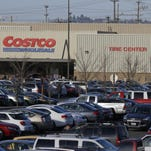 Cars fill the parking lot of a Costco store in Seattle on Nov. 24.
