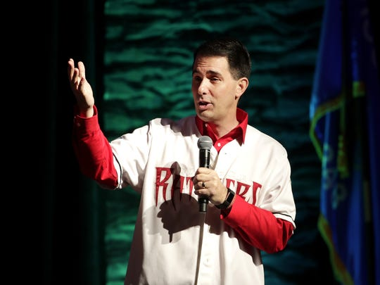 Gov. Scott Walker, dressed in a Wisconsin Timber Rattlers jersey, addresses the annual Governor's Conference on Tourism  on Monday at the Fox Cities Exhibition Center in Appleton. Danny Damiani/USA TODAY NETWORK-Wisconsin