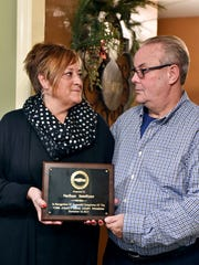 Sindy and Kerry Smeltzer hold their son Nate's York County Drug Treatment Court graduation plaque for a portrait in their Windsor Township home. Nate died in November one day before he was to graduate from York County Drug Treatment Court, a specialized program for non-violent offenders. An autopsy report confirmed that heroin and fentanyl were in Smeltzer's system at the time of his death. The coroner's office said November was one of the worst for such deaths, with a total of 19 suspected cases.
