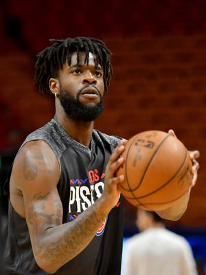 Detroit Pistons forward Reggie Bullock (25) warms up before a game against the Miami Heat at American Airlines Arena on Saturday, March 3, 2018.