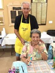 Gloria Gardner, with Bingo Committee member Bert Posner,