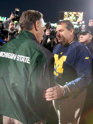 Michigan State head coach Mark Dantonio and Michigan head coach Brady Hoke after Michigan State won 35-11 on Saturday, October 25,2014 at Spartan Stadium in East Lansing.