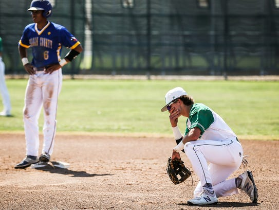 Wall's Tanner Seider reacts after he misses to tag