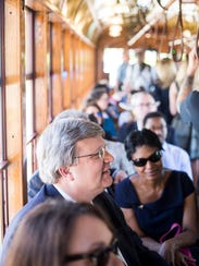 Memphis Mayor Jim Strickland rides on the first trolley