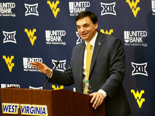 Neal Brown, West Virginia's new football coach, gestures while speaking during an introductory news conference in Morgantown, West Virginia on Jan. 10, 2019.