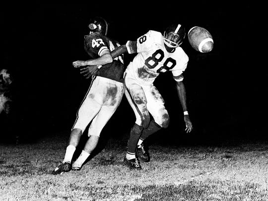 Antioch High defender Lester McClain (88) defends the