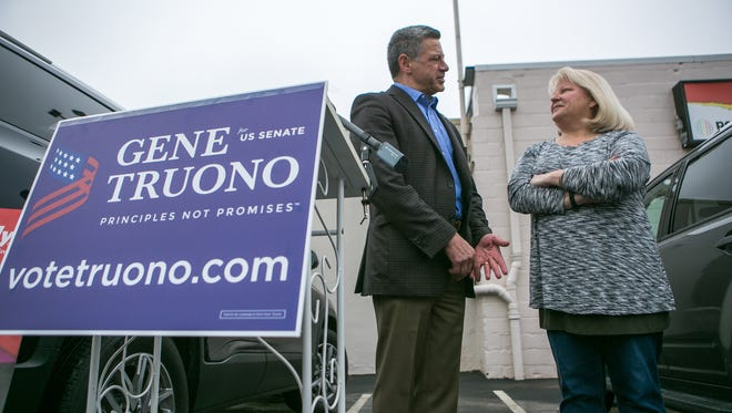 Former PayPal executive Gene Truono talks with Karen Nestor, co-owner of Popdot Signs & Graphics as he officially announces his candidacy for U.S. Senate.