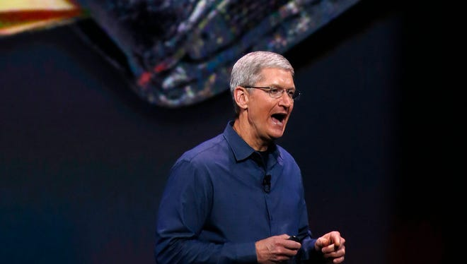 Apple CEO Tim Cook introduces the new Apple Pay system during Apple's launch event at the Flint Center for the Performing Arts in Cupertino, Calif., on Sept. 9, 2014.