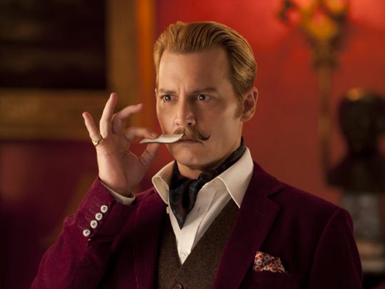 """Johnny Depp plays Charlie Mortdecai, a British art dealer tasked with finding a stolen painting, in """"Mortdecai."""""""