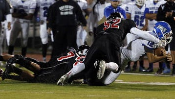 Nick Nyers makes a tackle against Carteret last season