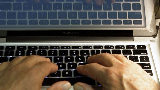 Companies including Google and the Huffington Post are trying everything from deploying moderators to forcing people to use their real names to restore civility in online comments. APFILE - In this Wednesday, Feb. 27, 2013 photo illustration, hands type on a computer keyboard in Los Angeles. Companies including Google and the Huffington Post are trying everything from deploying moderators to forcing people to use their real names in order to restore civil discourse on online comment threads. (AP Photo/Damian Dovarganes, File)