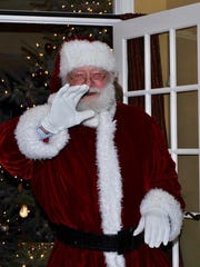 Hank Harris' signature white beard made him the ideal candidate to play Santa Claus.