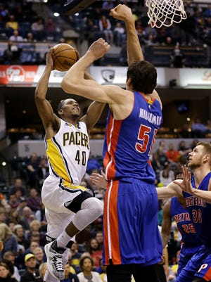 Indiana Pacers guard Glenn Robinson III (40) drives Detroit Pistons center Boban Marjanovic (51) in the second half of their game Wednesday, March 4, 2017, evening at Bankers Life Fieldhouse. The Indiana Pacers defeated the Detroit Pistons 115-98.