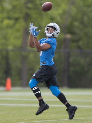 Detroit Lions receiver Golden Tate goes through passing drills during organized team activities Tuesday, June 6, 2017 at the practice facility in Allen Park.