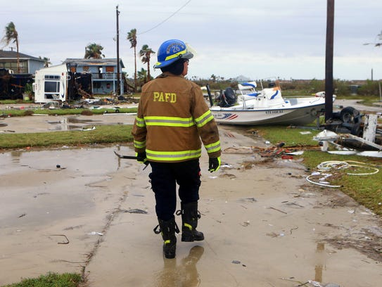 Port Aransas EMS Chief Tim McIntosh searches for stranded
