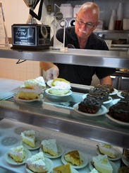 Larry Ahlhorn sets out a selection of pies for the