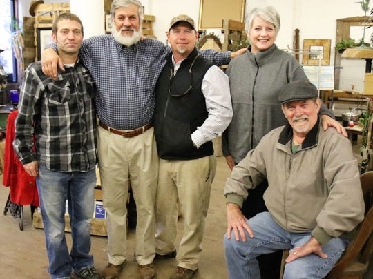 Reclaimed Concepts owners Chip Sheffield (left) and John Scott (third from left) welcome customers Fred Johnsey Jr. (second from left) and Wanda and David Stanfill Dec. 9 during a Christmas Open House in Bemis.