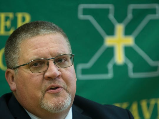 Kevin Wallace is the new football coach at St. Xavier