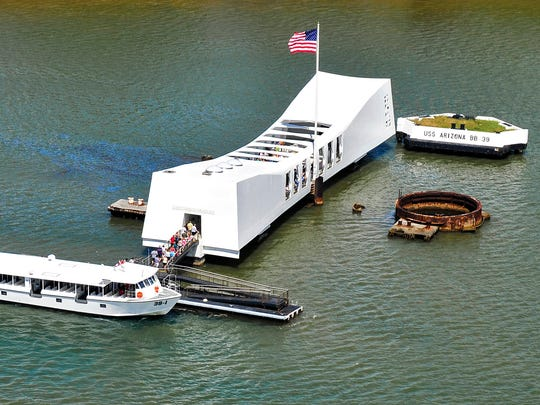 From a file photo, the USS Arizona Memorial in Honolulu marks the site where more than a thousand sailors died during the 1941 Japanese attack on Pearl Harbor.