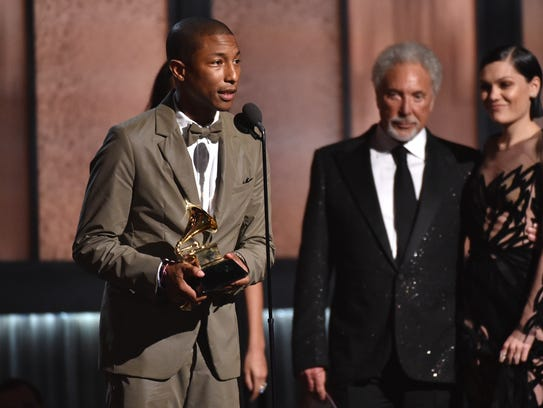 Pharrell Williams accepts the award for best pop solo