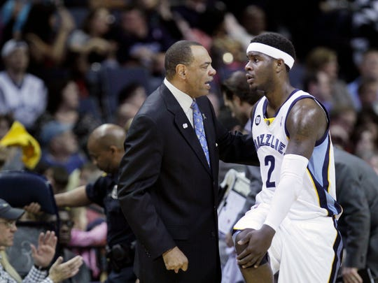 Memphis Grizzlies coach Lionel Hollins, center, talks with Memphis Grizzlies guard Josh Selby (2) during the first half of an NBA basketball game against the Portland Trail Blazers in Memphis, Tenn., Saturday, April 21, 2012. (AP Photo/Danny Johnston)
