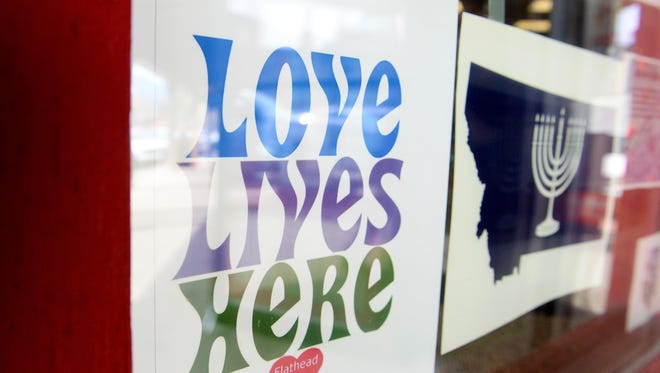 """""""Love Lives Here"""" is a slogan that grew out of pushback against a campaign of anti-Semitic online trolling against businesses and residents of the Whitefish, Montana. Residents joined together to stand up against the online hate speech and a proposed march by neo-Nazis, a march that never took place."""