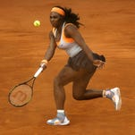 Serena Williams returns the ball to fellow American