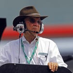 Team owner Jack Roush watches from a car hauler during practice for a NASCAR Xfinity Series auto race at Bristol Motor Speedway on Friday, April 17, 2015, in Bristol, Tenn.