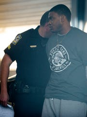 Markale Deandra Hart of Camp Hill, Ala., is taken into custody after being charged with felony murder in connection with the fatal shooting death of Jakell Mitchell, an Auburn football player, on Sunday.