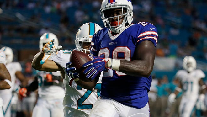Buffalo Bills running back Karlos Williams runs for a touchdown against the Dolphins.