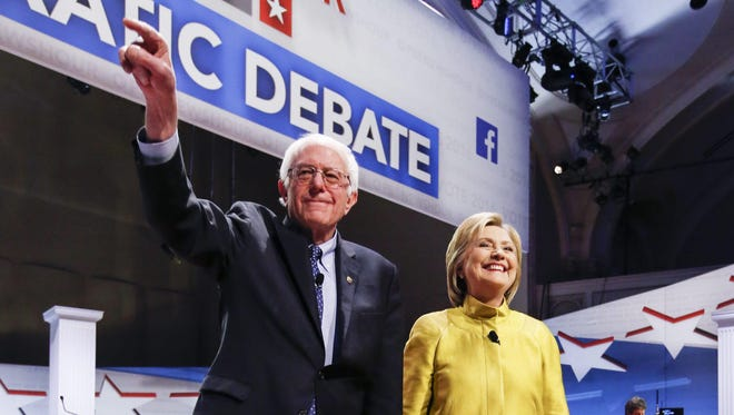 Sen. Bernie Sanders and Hillary Clinton participate in the PBS NewsHour Democratic presidential candidate debate in Milwaukee.