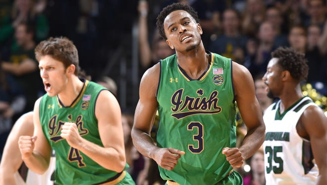 Notre Dame Fighting Irish forward V.J. Beachem (3) and forward Matt Ryan (4) react after a three point basket in the first half against the Loyola Greyhounds at the Purcell Pavilion.