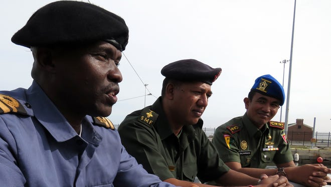 From left, officer-students Lt. Emmanuel Kailie of the Sierra Leone navy, Superintendent Hurrydeo Ramdany of the Mauritus Special Mobile Forces and Lt. Col. Medan Zulkarnain of the Indonesian army, talk about what they've learned and hope to learn as students taking the NETSAFA Anti-Terrorism and Piracy course.
