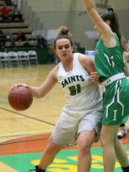 The Saints' Julia Hauer backs an Irvington defender