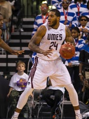 UMES's Mike Myers dribbles against Hampton in the MEAC