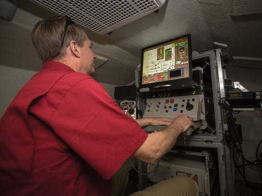 NMSU's Unmanned Aircraft Systems Operations Manager Tim Lower demonstrates remote piloting an unmanned aircraft inside a mobile control vehicle at the university's Physical Science Laboratory hangar at the Las Cruces Airport, March 17, 2016. Lower was there with others as part of an open house to demonstrate to the public NMSU's unmanned aircraft operations.