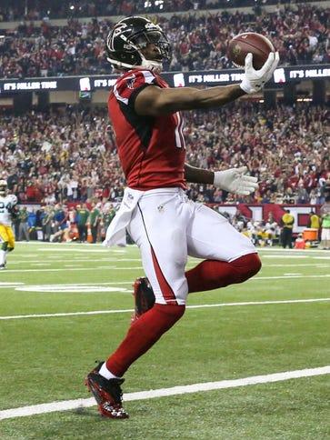 Atlanta Falcons wide receiver Julio Jones (11) scores