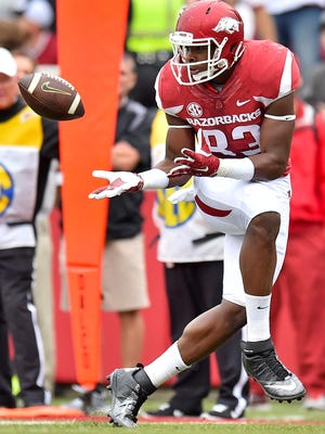 Arkansas tight end Jeremy Sprinkle (83) catches a pass from quarterback Brandon Allen against the Auburn Tigers during the first half at Donald W. Reynolds Razorback Stadium.