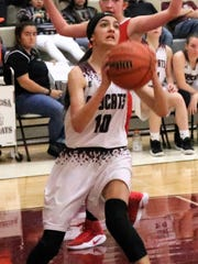 Tularosa's Allysa Montoya puts up a shot in the paint.