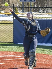 Morris Catholic catcher Katie Forte throws the ball