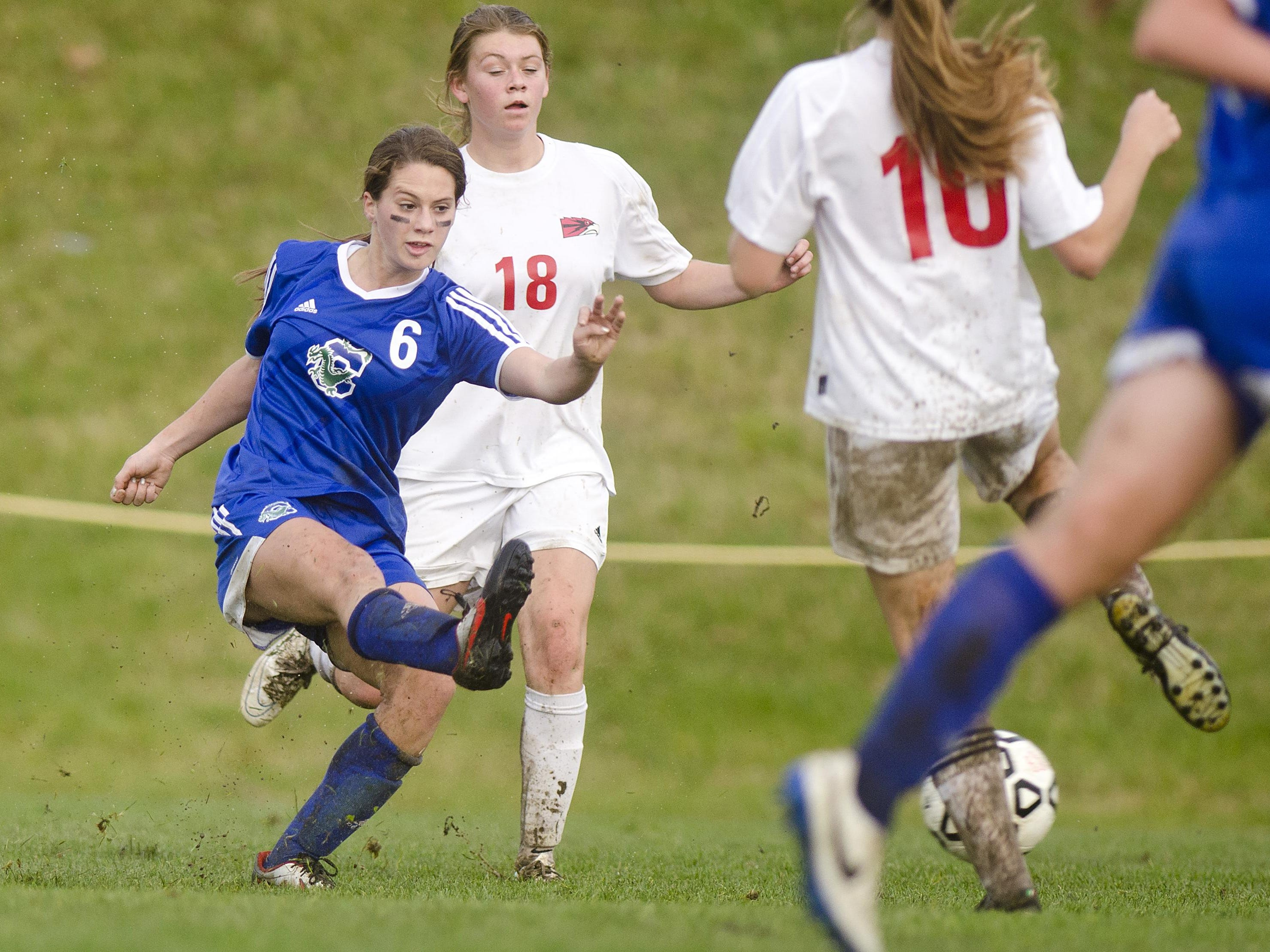 Colchester's Autumn Hathaway, left, attempts a shot against Champlain Valley during the second half of Tuesday's girls soccer playoff game in Hinesburg.