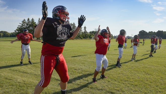 Rocori lineman Matt Waletzko and the rest of the team do Spartan jacks to warm up for practice last August at Rocori High School in Cold Spring. Waletzko, who will be a senior this fall, is receiving Division I college interest.