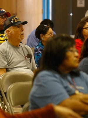 Community members participate on Friday in the eighth annual National Day of Remembrance hosted  by the Cold War Patriots at the Shiprock Chapter house.