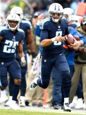 Titans quarterback Marcus Mariota (8) takes off for big yards in the first quarter against the Bengals at Nissan Stadium Sunday, Nov. 12, 2017 in Nashville, Tenn.