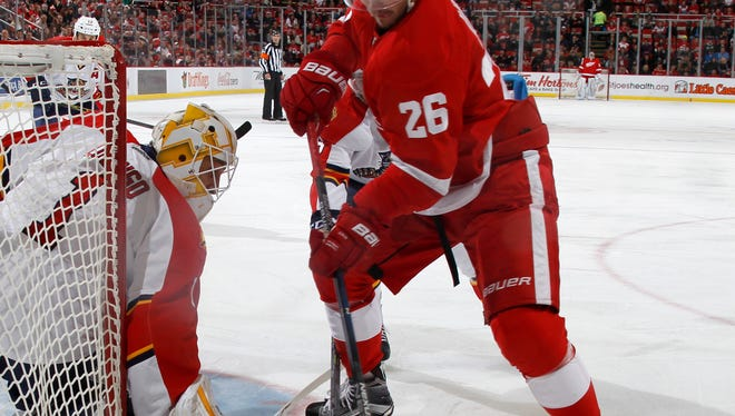 Red Wings forward Tomas Jurco taks a pass from Pavel Datsyuk as he tries to put a shot on Panthers  goalie Roberto Luongo in the first period of the Wings' 2-1 overtime loss Sunday at Joe Louis Arena.