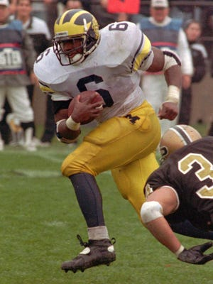 Michigan's Tyrone Wheatley runs past Purdue on Nov. 5, 1994.