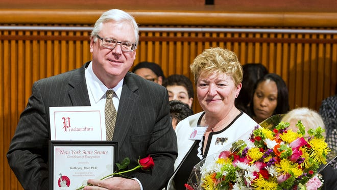 State Sen. Tom O'Mara, R-Big Flats, honors Chemung County native Kathryn Boor as a 2018 state Senate Woman of Distinction.
